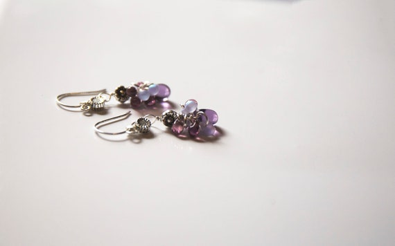 Sterling silver cluster earrings,  with Czech glass  teardrop beads in purple hues, and Tibetan silver accents.