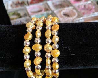 Memory wire bracelet- tangerine fresh water pearls with smaller silver spacer beads