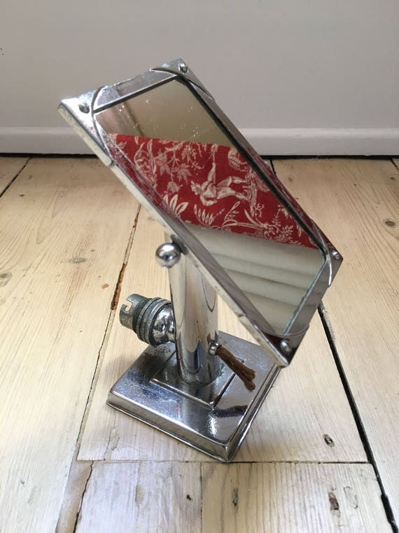 Art Deco chrome bathroom vanity adjustable mirror.