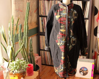 vintage peacock feather jacket . reversible quilted and vinyl black trench coat jacket by Koos Of Course . womens large xl