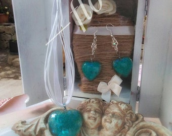 Set of earrings and necklace with heart pendant
