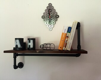 Vintage industrial style shelf in hydraulic pipes.