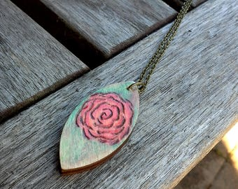 Rose floral necklace, woodburned pyrography, simple design, part of my serenity series, red pastel rose, green blue background, garden lover