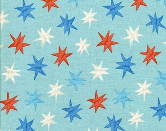 Multi-colored stars on blue sky background