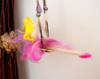 felted pink fairy on a swing