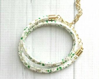 White Faux Leather Bracelet - vegan imitation round soft cord - leaves leaf blossom branch twig print - gold adjustable double wrap