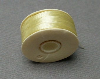 DIY Beads Nymo Thread. Size D. Stringing Supplies. Beadweaving Thread. Cream. Beading Thread. 64 yards. One bobbin (1).