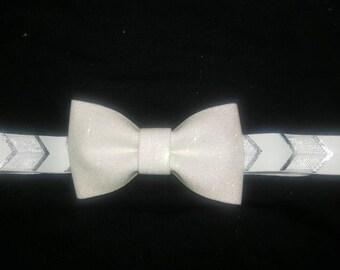 White glitter bow.