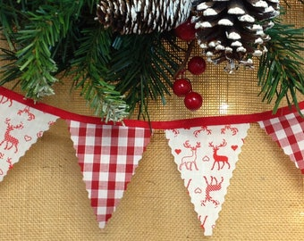 Nordic mini bunting with red stags and gingham attached to red tape, perfect for a traditional Christmas