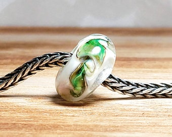 White with pops of happy green handmade glass lampwork bead
