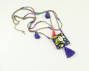Ethnic necklace amulet is happiness, Wax, cowrie and tassels.
