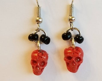 Red skull dangle earrings