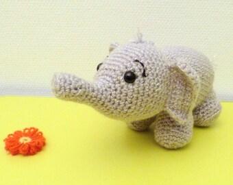 Adorable little shiny grey elephant!