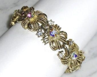 """Vintage 7 1/4 inch Gold Tone Aurora Borealis Rhinestone Link Bracelet signed """"Coro"""""""