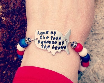Home of the Free Because of the Brave Bracelet helps provide service dogs to military veterans soldiers USA United States America