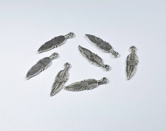 Set of 7 feather charms silver plated