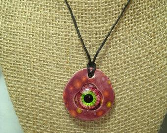 Handmade Ceramic Scary Purple Eyeball Monster Necklace.