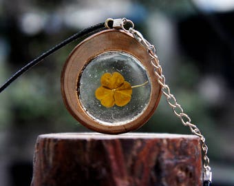 handmade hollowed plant necklace