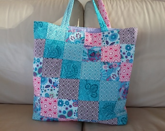 Large patchwork quilted bag.