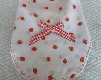 White dress with printed red strawberries.