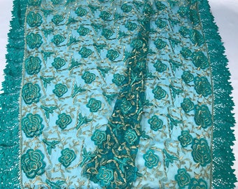 Teal green floral design embroider with metallic gold tread on a mesh lace-dresses-fashion-decorations-apparel-prom-nightgown-sold by yard.