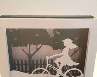 card 3d woman on bicycle with envelope