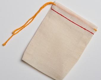 50 3x4 Natural Cotton Muslin Red Hem and Orange Drawstring Bags
