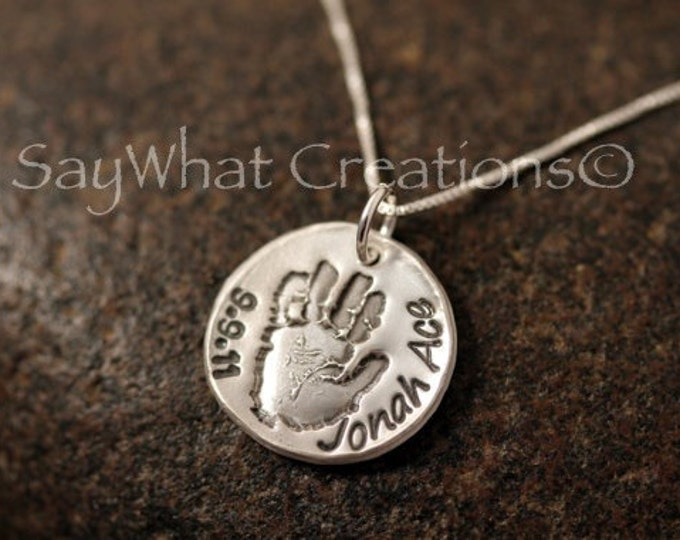 Your baby or child's ACTUAL hand prints made into silver pendants Includes one hand print charm with stamped name and birthday