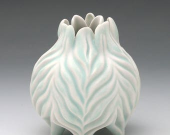 Carved porcelain aqua blue and white squat vase