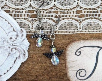 Angel earrings with metal and glass beads.