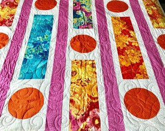 Vibrant Colors and Bold Floral Print Quilt