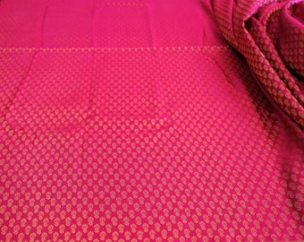 hot pink brocade fabric with golden leafy pattern