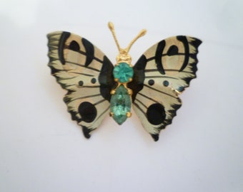 BUTTERFLY BROOCH.  Butterfly Has Enameled Wings And Two Sparkling Aqua Rhinestones. Vintage Gold Toned Setting Butterfly Brooch.