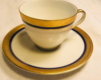 La Reine demitasse cup and saucer by Franconia-Krautheim, gold encrusted, cobalt blue band