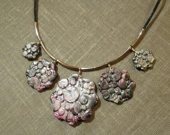 Beautiful necklace of polymer clay flowers.