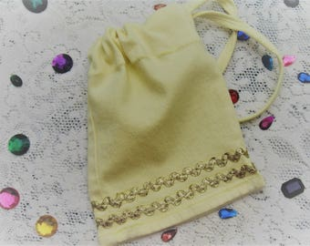 Yellow dtraw string pouch