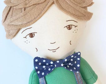 Heirloom Doll : light brown hair boy doll with bow tie