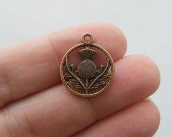 16 Thistle charms antique copper tone CC44