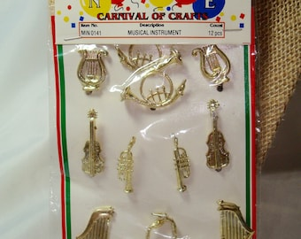 Vintage New Miniature Golden Musical Instruments in a 12 Pack.