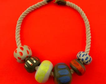 Six bead necklace on cotton rope