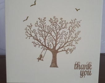A hand stamped 5x5 inch thank you card