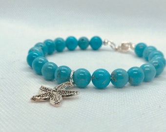 Turquoise howlite beaded bracelet with starfish charm