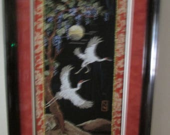Cranes flying at night completed cross stitch