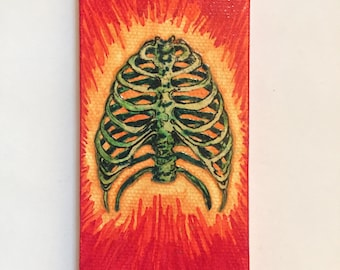 Nouveau Bone Fig.17 Human rib cage illustration hand cut and collaged onto a mini canvas. Bright and colorful w/ green yellow red & orange.