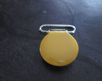 a clip / pacifier round yellow enameled metal