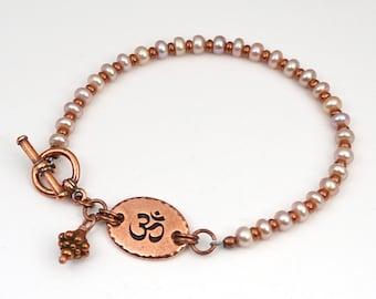 Tibetan Om bracelet, pink freshwater pearls, copper Zen jewelry, 8 inches long