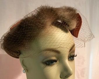 Vintage woman's Peach satin mink veiled hat