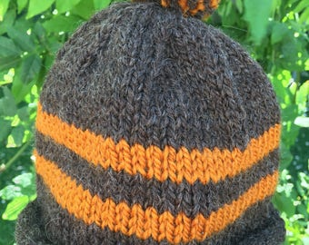 Fun childs beanie in dark brown with gold stripes and pom pom