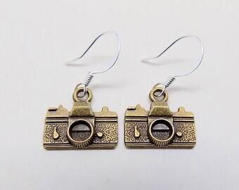 Steampunk camera earrings.
