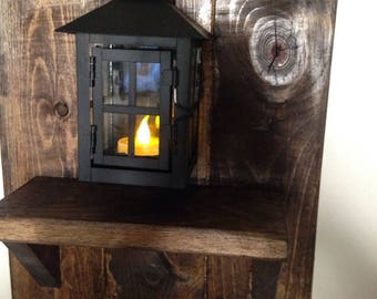 wood wall decor with shelf and lantern candle holder